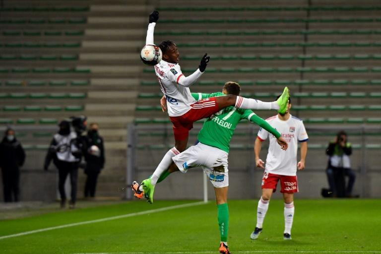 Tino Kadewere (L) of Lyon clashes with Baptiste Gabard of Saint-Etienne in Ligue 1
