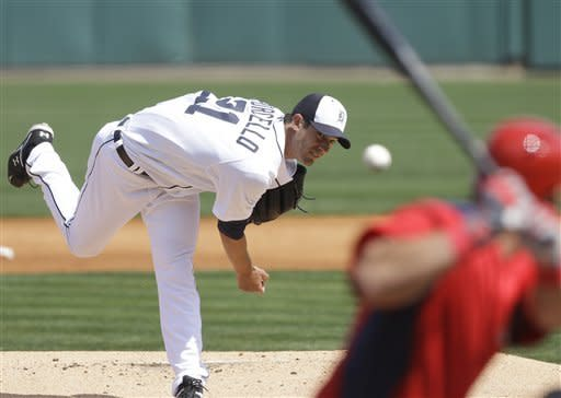 Detroit Tigers starting pitcher Rick Porcello (21) throws during the first inning of an exhibition spring training baseball game against the Washington Nationals, Sunday, March 10, 2013, in Lakeland, Fla. (AP Photo/Carlos Osorio)