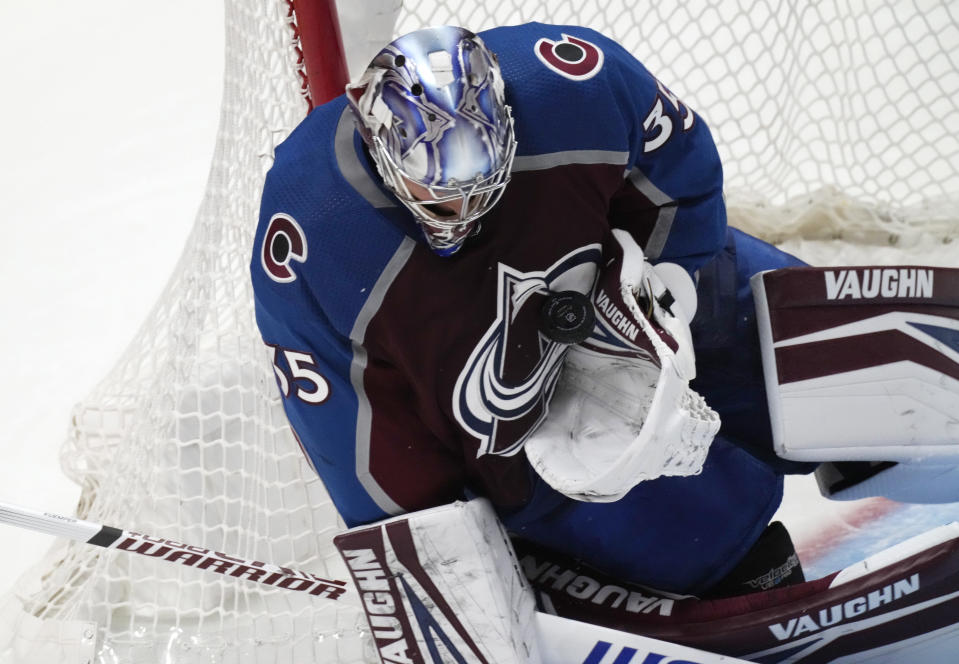 Colorado Avalanche goaltender Darcy Kuemper makes a glove save on a Chicago Blackhawks shot during the second period of an NHL hockey game Wednesday, Oct. 13, 2021, in Denver. (AP Photo/David Zalubowski)