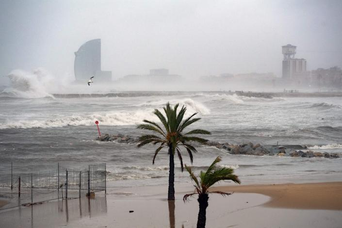 W Barcelona hotel is pictured in the mist while big waves hit El Bogatell beach in Barcelona as storm Gloria batters the Spanish eastern coast (Getty)