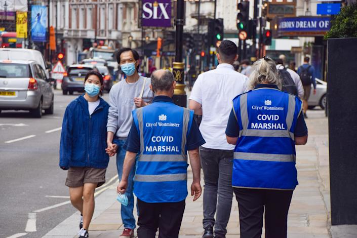 COVID-19 Marshals seen on patrol in Shaftesbury Avenue, central London, as coronavirus infections continue to rise again in England. (Photo by Vuk Valcic / SOPA Images/Sipa USA)