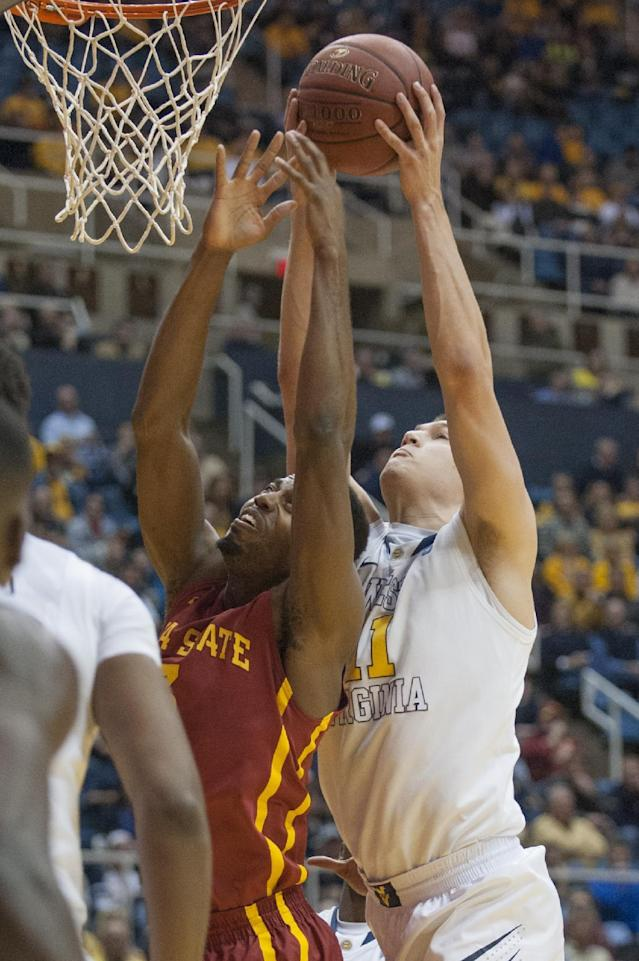 West Virginia's Nathan Adrian, right, rebounds over Iowa State's Melvin Ejim during the first half of an NCAA college basketball game Monday, Feb. 10, 2014, in Morgantown, W.Va. (AP Photo/Andrew Ferguson)