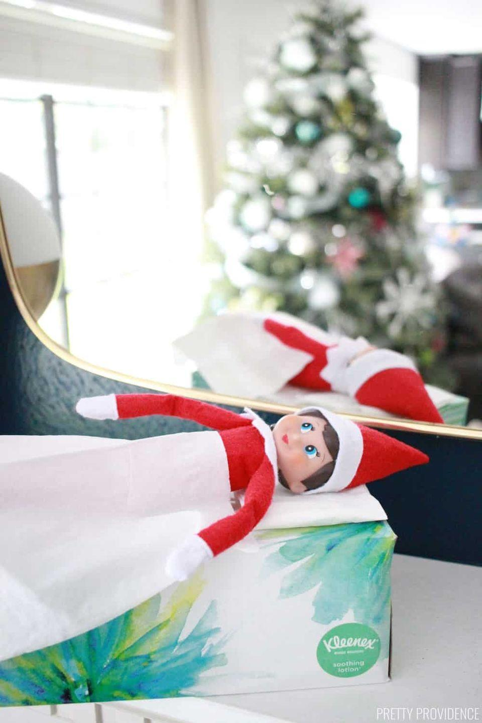 """<p>When your kids wake up on the first day of Elf Return Week, they'll be so glad to see this little guy waking up too! Place the """"bed"""" in their bedroom so that they have a chance to see it first thing in the morning.</p><p><strong>Get the tutorial at <a href=""""https://prettyprovidence.com/elf-on-the-shelf/"""" rel=""""nofollow noopener"""" target=""""_blank"""" data-ylk=""""slk:Pretty Providence"""" class=""""link rapid-noclick-resp"""">Pretty Providence</a>.</strong></p><p><strong><a class=""""link rapid-noclick-resp"""" href=""""https://www.amazon.com/tissue-holders/b?ie=UTF8&node=13749811&tag=syn-yahoo-20&ascsubtag=%5Bartid%7C10050.g.29656008%5Bsrc%7Cyahoo-us"""" rel=""""nofollow noopener"""" target=""""_blank"""" data-ylk=""""slk:SHOP TISSUE HOLDERS"""">SHOP TISSUE HOLDERS</a><br></strong></p>"""