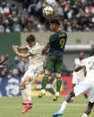 Portland Timbers forward Felipe Mora (9) heads the ball against Los Angeles FC during an MLS soccer match Sunday, Sept. 19, 2021, in Portland, Ore. (Sean Meagher/The Oregonian via AP)
