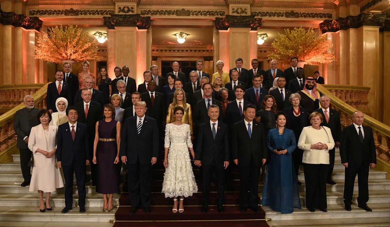 G20 leaders and their partners pose for a photo at the Colon Theatre during a gala at the G20 leaders summit in Buenos Aires, Argentina, Nov. 30, 2018. (Photo: G20 Argentina/Handout via Reuters)