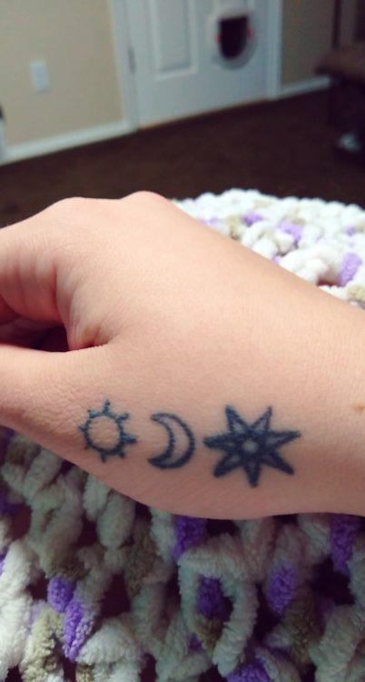 Destiny shows the viewer three tattoos, one of the sun, one of the moon, one of a seven-pointed star. It is located on her hand.