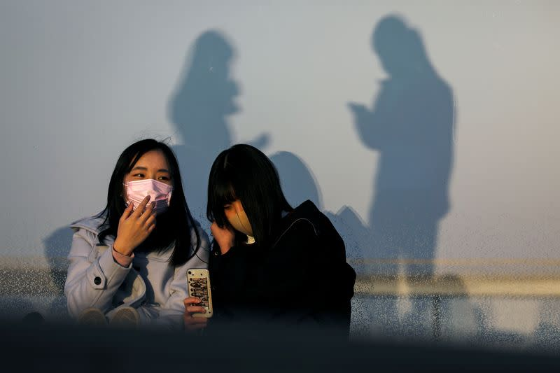 People wearing protective masks are seen at the Shibuya sky observation deck, following an outbreak of the coronavirus in Tokyo