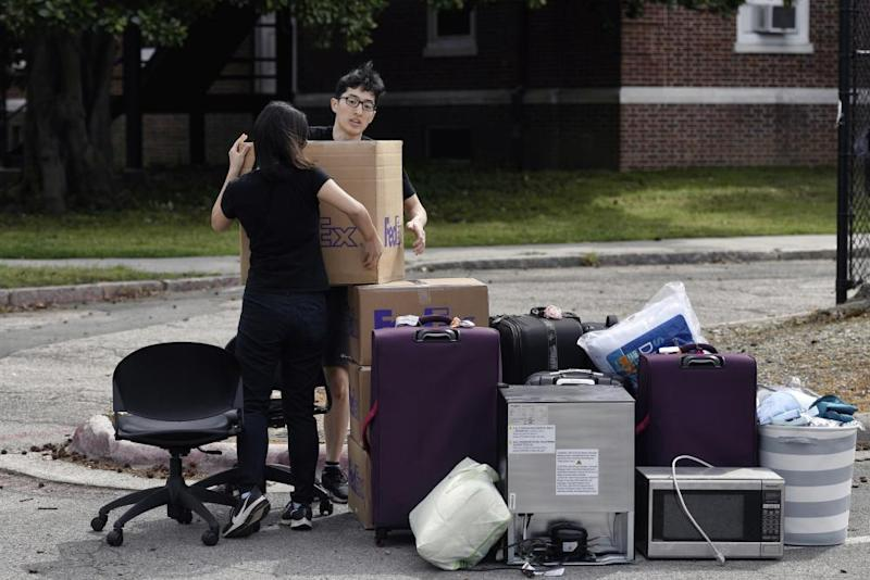 Duke freshmen Feng Cong from Singapore and Cassie Lu from Thailand move out of their dorm at Duke University on 15 March.