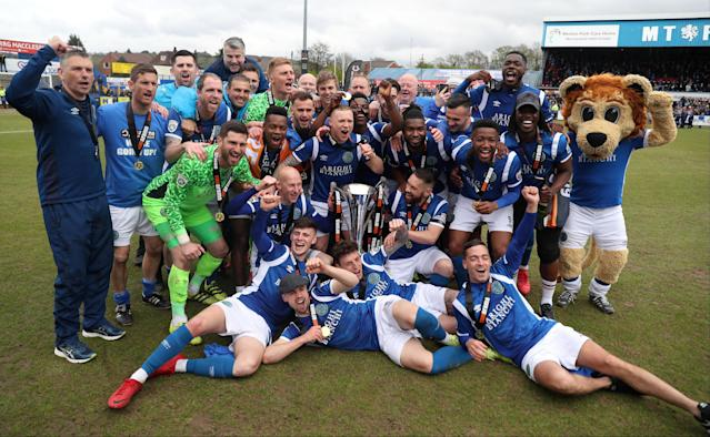 Soccer Football - National League - Macclesfield Town v Dagenham & Redbridge - Moss Rose, Macclesfield, Britain - April 28, 2018 Macclesfield Town celebrate winning the national league with the trophy Action Images/Peter Cziborra