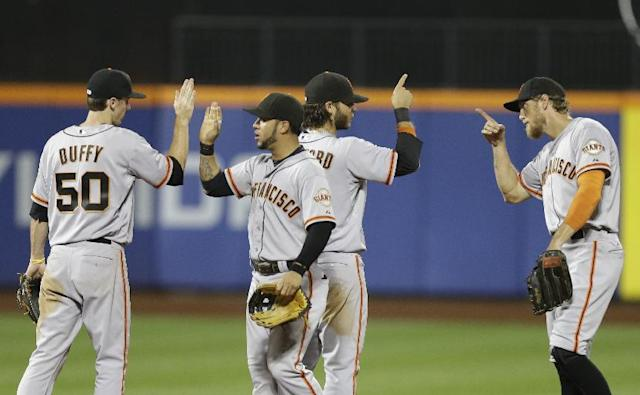 San Francisco Giants' Hunter Pence, Brandon Crawford, Gregor Blanco and Matt Duffy, from right, celebrate after a baseball game against the New York Mets on Friday, Aug. 1, 2014, in New York. The Gaints won 5-1. (AP Photo/Frank Franklin II)