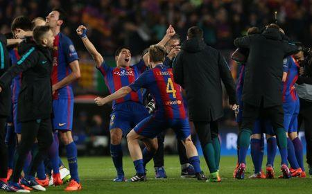 Barcelona's Lionel Messi and Ivan Rakitic celebrate after the game