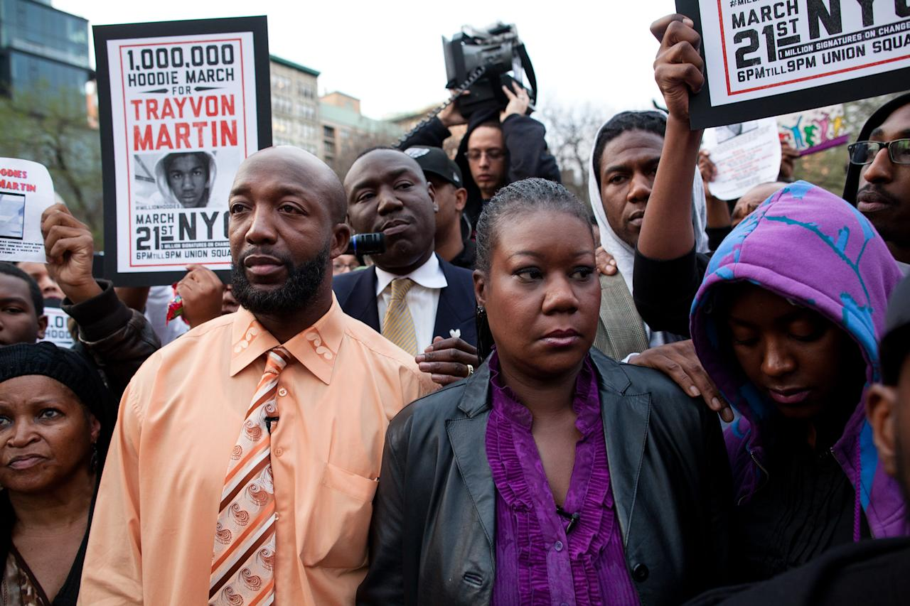 Trayvon Martin's parent's Tracy Martin, left, and Sybrina Fulton, center, are joined by an unidentified woman during the Million Hoodie March in Union Square Wednesday, March 21, 2012 in New York. A few hundred people were marching in New York City in memory of Trayvon Martin, a black teenager shot to death by a Hispanic neighborhood watch captain in Florida. The teenager was unarmed and was wearing a hoodie. (AP Photo/John Minchillo)