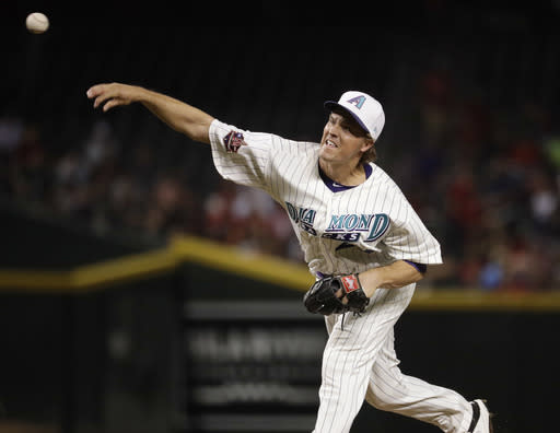 Arizona Diamondbacks starting pitcher Zack Greinke throws to a San Francisco Giants batter during the fifth inning of a baseball game Thursday, April 19, 2018, in Phoenix. (AP Photo/Matt York)