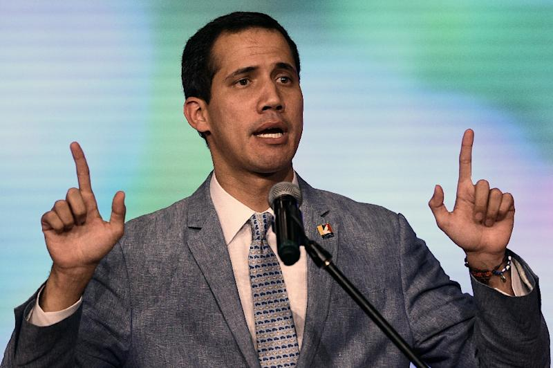 The president of Venezuela's National Assembly and self-proclaimed acting president Juan Guaido delivers a speech at the Central University of Venezuela (UCV) in Caracas on February 8, 2019