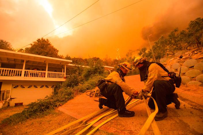 Firefighters battle the Lake Hughes fire in Angeles National Forest on Wednesday, Aug. 12, 2020, north of Santa Clarita, Calif.