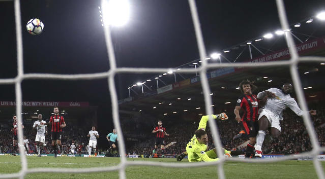 Manchester United's Romelu Lukaku, right, scores his side's first goal of the game during the Premier League match at the Vitality Stadium, Bournemouth, Wednesday April 18, 2018. (Adam Davy/PA via AP)