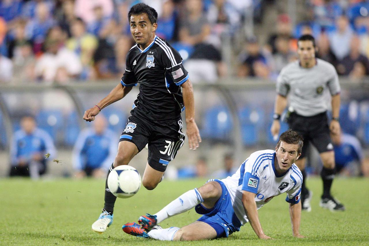 MONTREAL, CANADA - AUGUST 18: Rafael Baca #30 of the San Jose Earthquakes moves the ball past Jeb Brovsky #15 of the Montreal Impact during the match at the Saputo Stadium on August 18, 2012 in Montreal, Quebec, Canada.  (Photo by Richard Wolowicz/Getty Images)