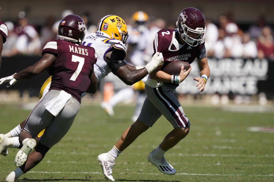 LSU defensive end Ali Gaye (11) pulls down Mississippi State quarterback Will Rogers (2) for a loss during the first half of an NCAA college football game, Saturday, Sept. 25, 2021, in Starkville, Miss. (AP Photo/Rogelio V. Solis)