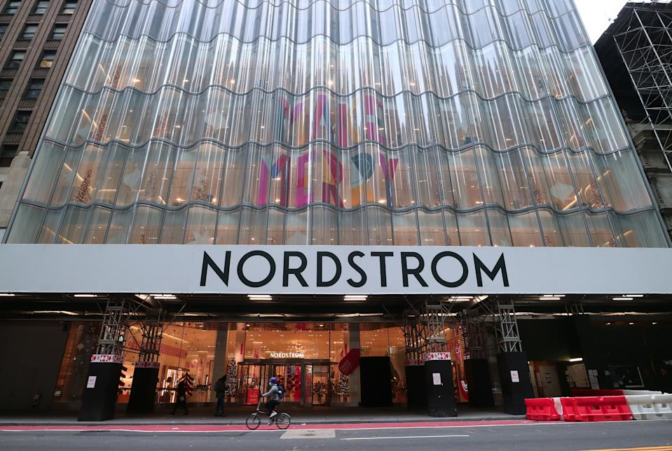 NEW YORK, NY - DECEMBER 8: A person rides past the Nordstrom department store decorated for Christmas on 57th Street on December 8, 2020 in New York City. (Photo by Gary Hershorn/Getty Images)