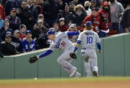 Oct 23, 2018; Boston, MA, USA; Los Angeles Dodgers outfielder Joc Pederson (31) and third baseman Justin Turner (10) cannot catch a ball hit for a double by Boston Red Sox outfielder Andrew Benintendi (not pictured) in the seventh inning in game one of the 2018 World Series at Fenway Park. Bob DeChiara-USA TODAY Sports