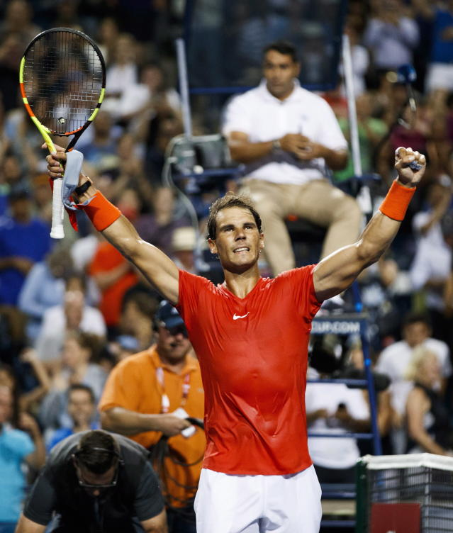Rafael Nadal, of Spain, celebrates defeating Benoit Paire, of France, during the Rogers Cup mens tennis tournament in Toronto, Wednesday, Aug. 8, 2018. (Mark Blinch/The Canadian Press via AP