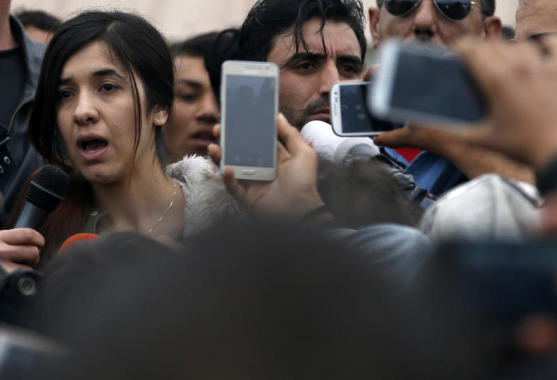 FILE - In this Sunday, April 3, 2016 file photo, Islamic State rape victim Iraqi Yazidi Nadia Murad, left, speaks during her visit in a makeshift refugee camp at the northern Greek border point of Idomeni, Greece. On Friday, Oct. 5, 2018, the activist was awarded the Nobel Peace Prize. (AP Photo/Darko Vojinovic)