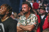 Jacksonville Jaguars quarterback Gardner Minshew watches a UFC 261 mixed martial arts bout, Saturday, April 24, 2021, in Jacksonville, Fla. It is the first UFC event since the onset of the COVID-19 pandemic to feature a full crowd in attendance. (AP Photo/Gary McCullough)