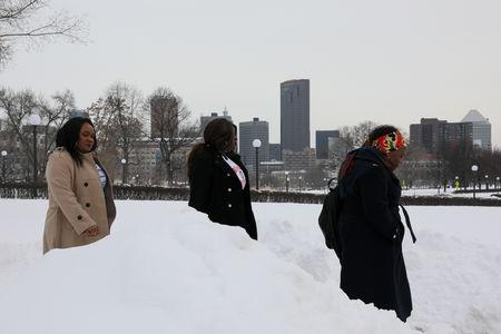 Women depart in the snow after a Deferred Enforced Departure (DED) rally at the Minnesota State Capitol in St. Paul, Minnesota, U.S., February 22, 2019. REUTERS/Jonathan Ernst