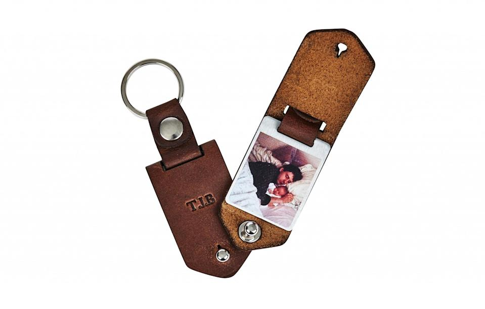 """<p><a href=""""https://www.notonthehighstreet.com/creategiftlove/product/personalised-metal-photo-keyring-with-leather-case"""" rel=""""nofollow noopener"""" target=""""_blank"""" data-ylk=""""slk:Not On The High Street, £26"""" class=""""link rapid-noclick-resp"""">Not On The High Street, £26</a> </p>"""