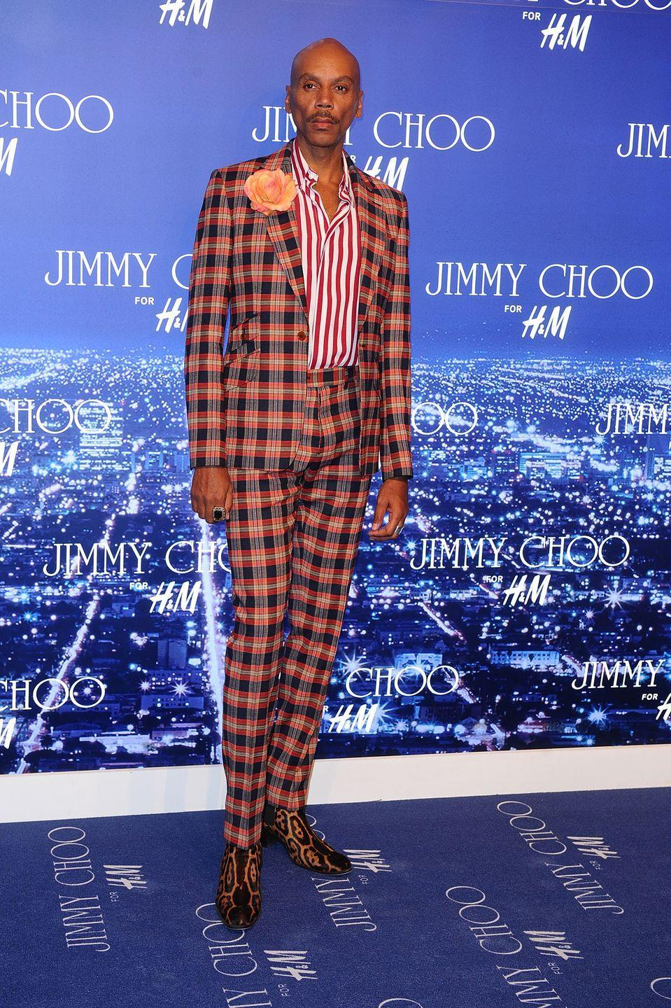 <p>In the last decade or so, RuPaul has most often been spotted on the red carpets (or in this case blue) wearing some perfectly tailored suits, and this pattern mix is spot on. </p>
