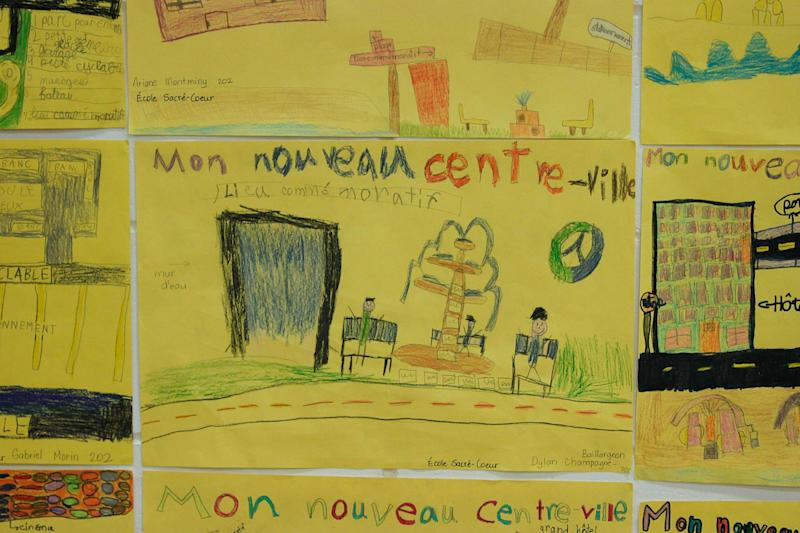 Artwork done by kindergarten children showing their vision for reconstruction of Lac-Megantic, Quebec, Canada is seen on June 17, 2014 (AFP Photo/Clement Sabourin)