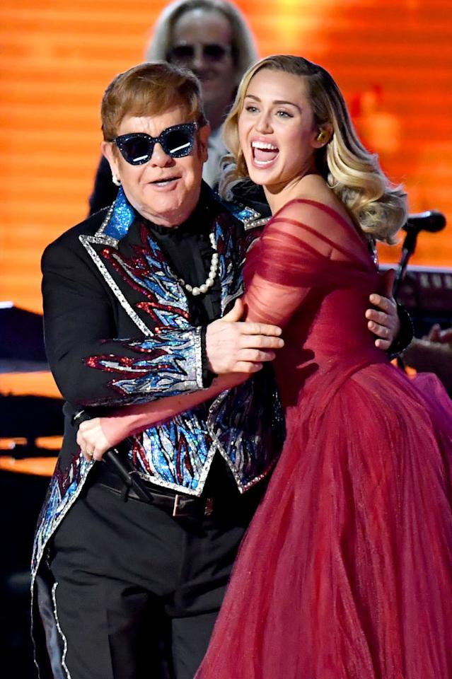 Elton John and Miley Cyrus perform at the Grammys. (Photo: Jeff Kravitz/FilmMagic)