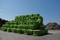 Packages of a plastic waste are seen at Extruplas plant in Seixal