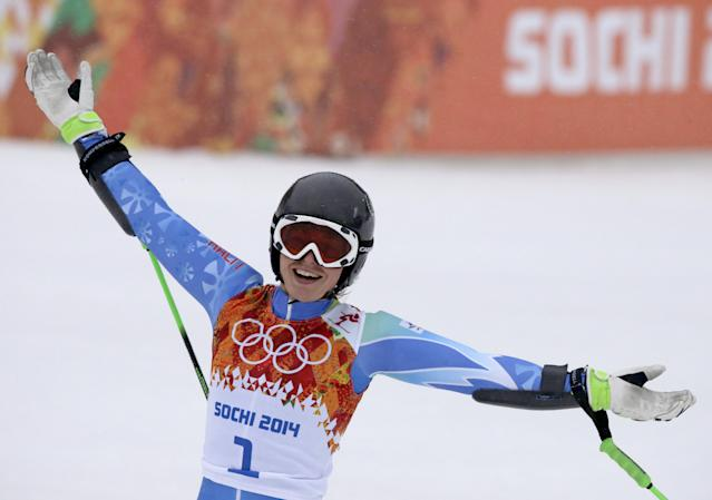 Slovenia's Tina Maze celebrates after taking the lead in the second run of the women's giant slalom at the Sochi 2014 Winter Olympics, Tuesday, Feb. 18, 2014, in Krasnaya Polyana, Russia. (AP Photo/Gero Breloer)