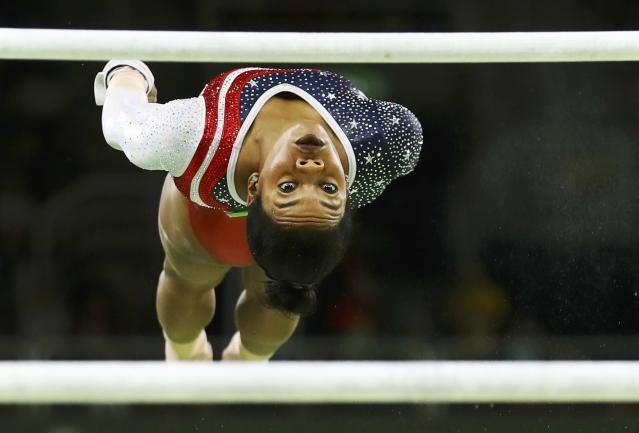 2016 Rio Olympics - Artistic Gymnastics - Final - Women's Team Final - Rio Olympic Arena - Rio de Janeiro, Brazil - 09/08/2016. Gabrielle Douglas (USA) of USA (Gabby Douglas) competes on the uneven bars during the women's team final. REUTERS/Mike Blake TPX IMAGES OF THE DAY FOR EDITORIAL USE ONLY. NOT FOR SALE FOR MARKETING OR ADVERTISING CAMPAIGNS.