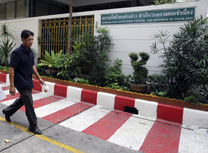 """A Thai policeman walks past Thai Immigration Police detention center in Bangkok Sunday, April 1, 2012, where Vito Roberto Palazzolo, a fugitive Italian banker implicated in the """"Pizza Connection"""" drug and money laundering trial, is being held for questioning. Palazzolo has been detained in Thailand after Italian authorities tracked his whereabouts on Facebook, authorities said Saturday. (AP Photo/Sakchai Lalit)"""
