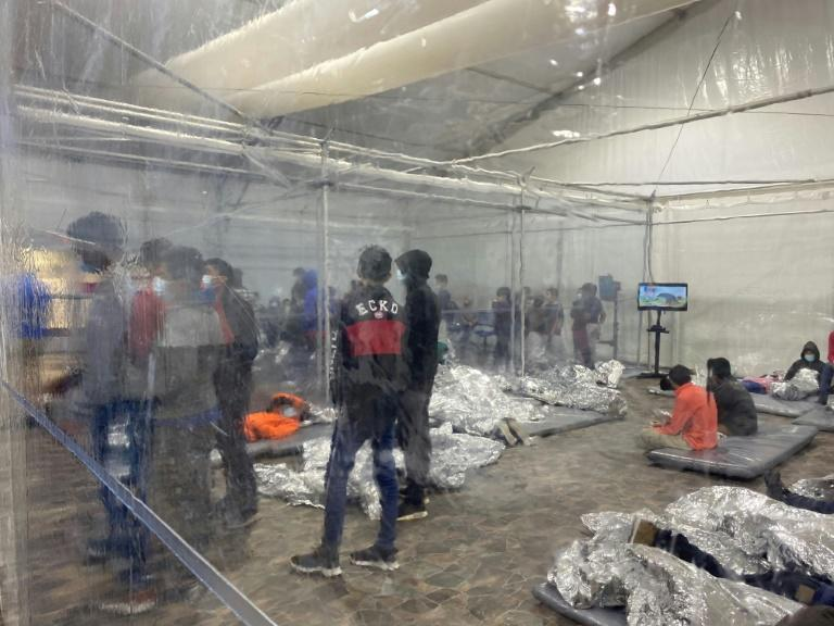 A photograph courtesy of Congressman Henry Cuellar (TX-28), released on March 22, 2021, shows migrants inside of a US Customs and Border Protection temporary overflow facility in Donna, Texas