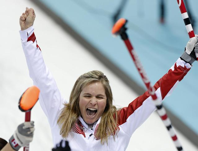 Canada's skip Jennifer Jones celebrates after delivering the last rock during the women's curling semifinal game against Britain at the 2014 Winter Olympics, Wednesday, Feb. 19, 2014, in Sochi, Russia. (AP Photo/Robert F. Bukaty)