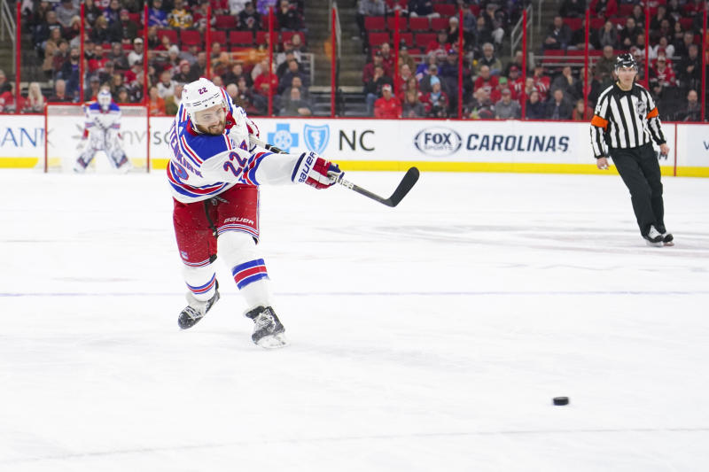 Feb 19, 2019; Raleigh, NC, USA; New York Rangers defenseman Kevin Shattenkirk (22) takes a slap shot against the Carolina Hurricanes at PNC Arena. The New York Rangers defeated the Carolina Hurricanes 2-1. Mandatory Credit: James Guillory-USA TODAY Sports
