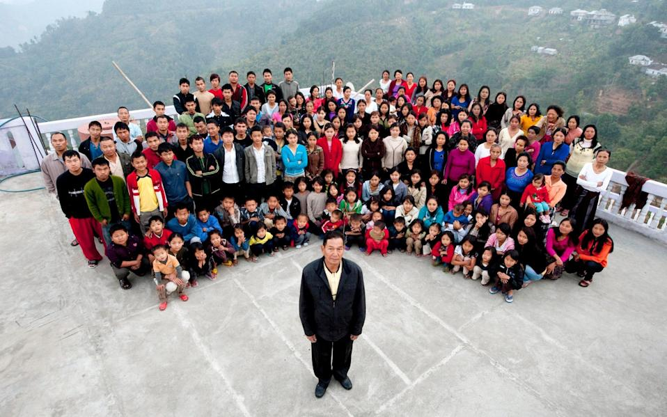 A family photograph of the Ziona family, with a total of 181 members. Ziona Chana, 67, is at the front - Barcroft Media