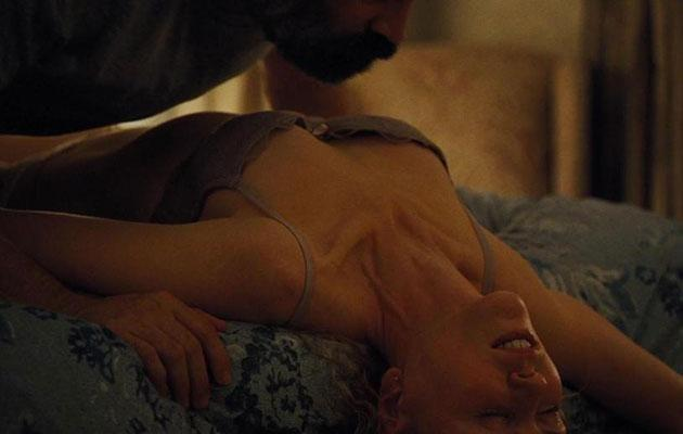 Her on-screen husband then proceeds to remove her clothing and kiss her. Source: New Sparta Films