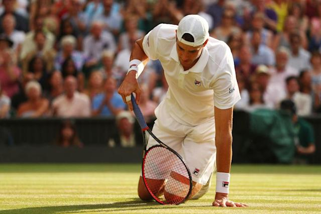 John Isner reacts after a point in his marathon semifinal match against Kevin Anderson at Wimbledon. (Getty Images)