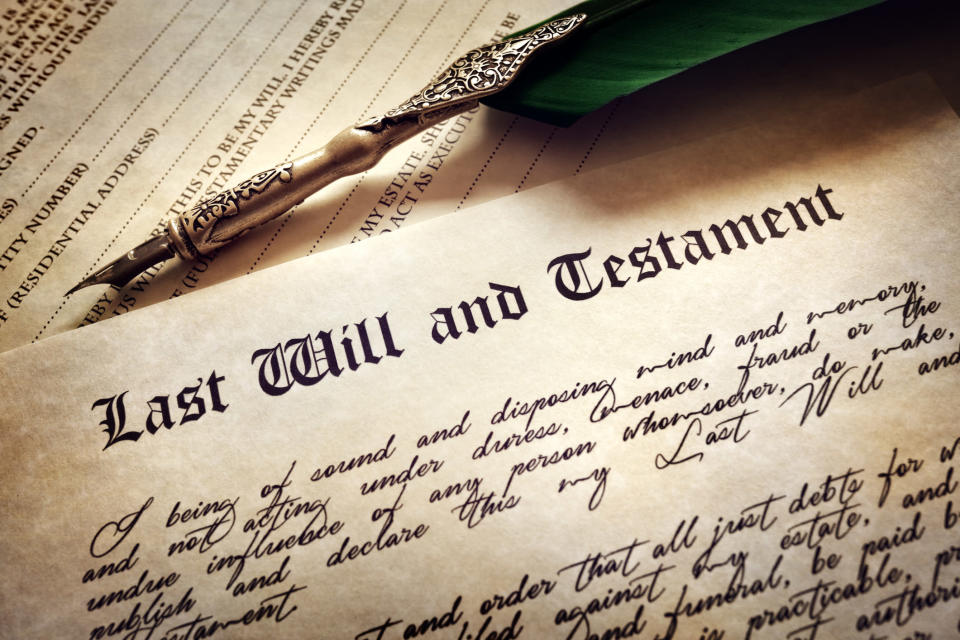 Document that says Last Will and Testament, with an ornamental fountain pen above it.