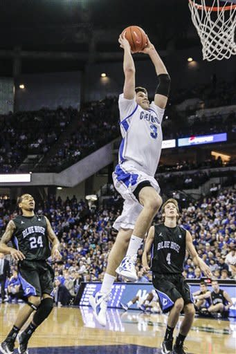 Creighton's Doug McDermott (3) goes up for a dunk against Presbyterian's Khalid Mutakabbir (24) and Austin Anderson (4) in the first half of an NCAA college basketball game in Omaha, Neb., Sunday, Nov. 18, 2012. (AP Photo/Nati Harnik)