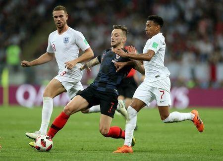 Soccer Football - World Cup - Semi Final - Croatia v England - Luzhniki Stadium, Moscow, Russia - July 11, 2018 Croatia's Ivan Rakitic in action with England's Jesse Lingard REUTERS/Carl Recine
