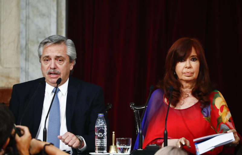 Argentina's President Alberto Fernandez, left, speaks sitting next to Vice President Cristina Fernandez as he opens the 2020 session of Congress in Buenos Aires, Argentina, Sunday, March 1, 2020. (AP Photo/Marcos Brindicci)