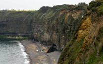 In this May 1, 2019, photo, the cliffside of Pointe du Hoc overlooking Omaha Beach in Saint-Pierre-du-Mont, Normandy, France. On June 6, 1944, U.S. Rangers scaled the coastal cliffs to capture a German gun battery. (AP Photo/Virginia Mayo)