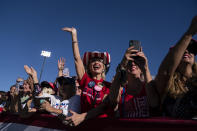 Supporters cheer as President Donald Trump arrives for a campaign rally at Phoenix Goodyear Airport, Wednesday, Oct. 28, 2020, in Goodyear, Ariz. (AP Photo/Evan Vucci)