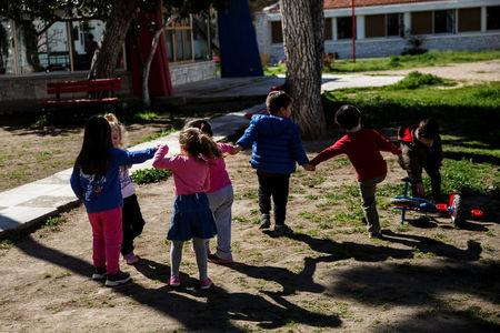Children play in the yard of the Model National Nursery of Kallithea, in Athens