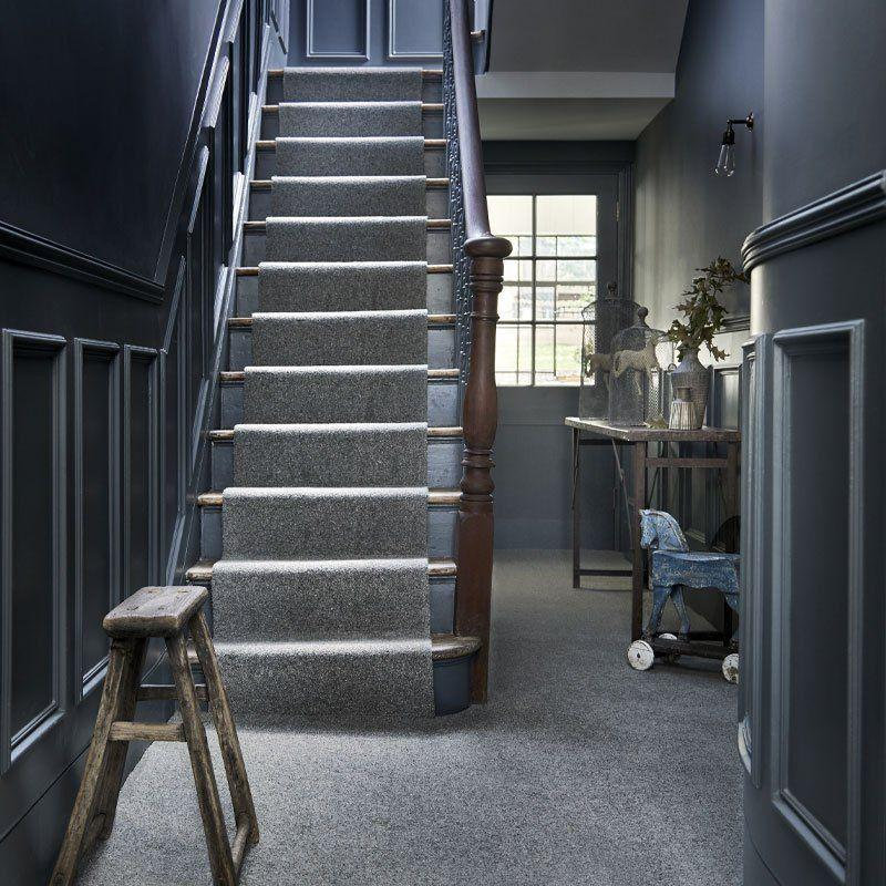 """<p>Grey is a bit of a gift when it comes to colour schemes because it goes with just about anything. A grey on grey is frequently avoided for fear of darkening a room too much, but it can be impactful in transitional spaces such as the stairs, a hallway, or landing. The natural materials here - an abundance of wood and wool - warms up the entire space. <br></p><p>Pictured: <a href=""""https://www.carpetright.co.uk/carpets/monmouth-twist-carpet/?VariationId=V_5637527828"""" rel=""""nofollow noopener"""" target=""""_blank"""" data-ylk=""""slk:Country Living Monmouth Twist Carpet at Carpetright"""" class=""""link rapid-noclick-resp"""">Country Living Monmouth Twist Carpet at Carpetright</a></p>"""